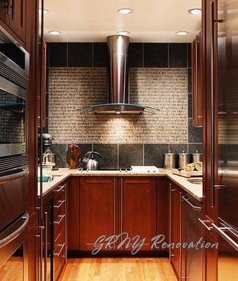 Tiny Kitchen With Cherry Cabinets And Stainless Steel Appliances