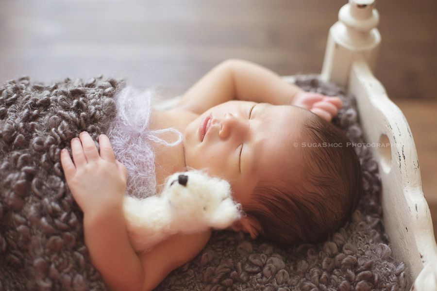 Newborn Photographer Bucks County PA | Doylestown PA. newborn baby girl in newborn bed prop with woolywishes bear