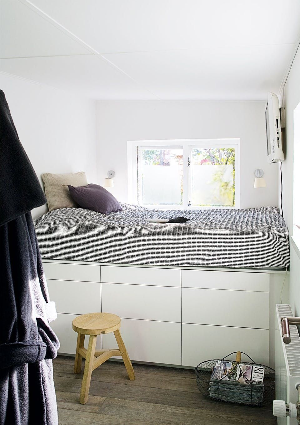 Nice bedroom with neat storage space under the bed.