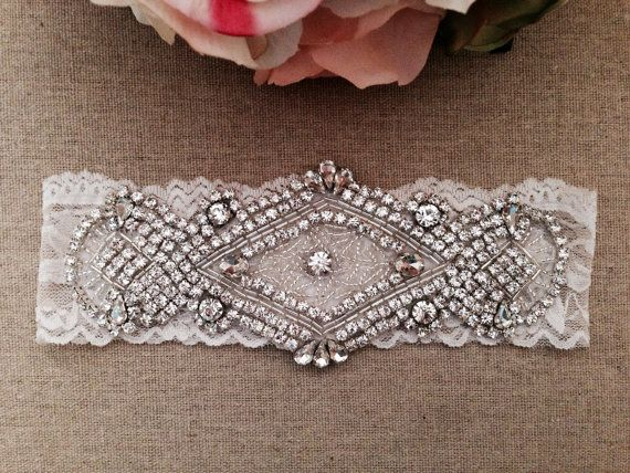 *Perfect for your special day!!    *Main garter only    **This gorgeous rhinestone crystal piece measures about 6.5in by 3in and is attached to