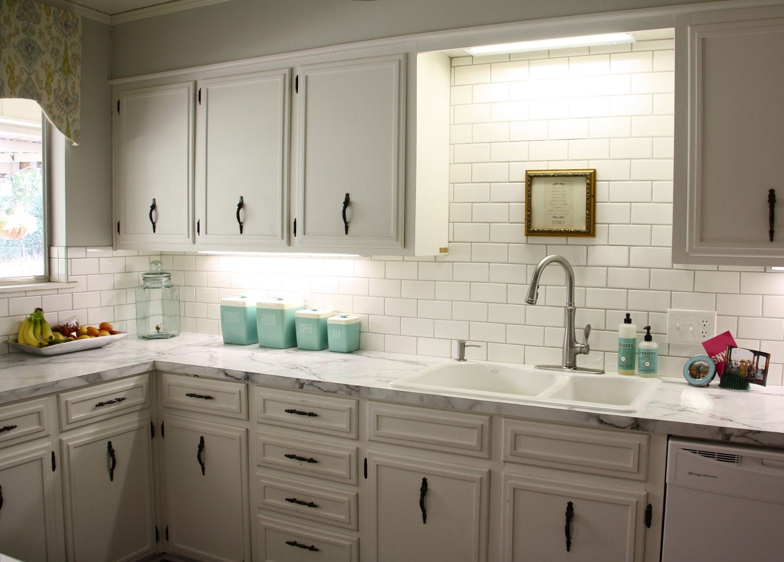 Like the cornice going across the sink with the spot lighting ...
