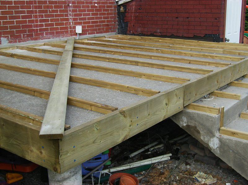 Building a wooden deck over a concrete one porch roof for Building a front porch deck