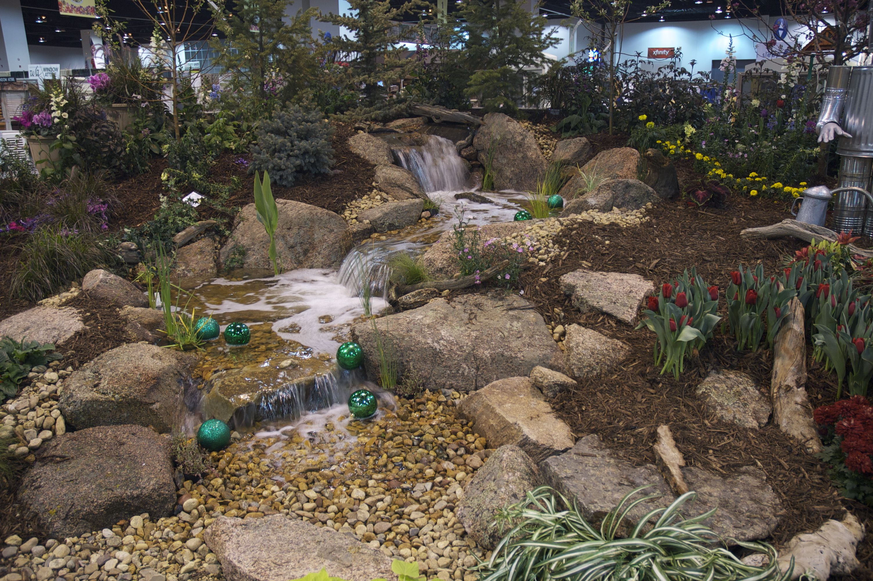 A beautiful pondless waterfall enhances the way to Oz. | Wizard of ...