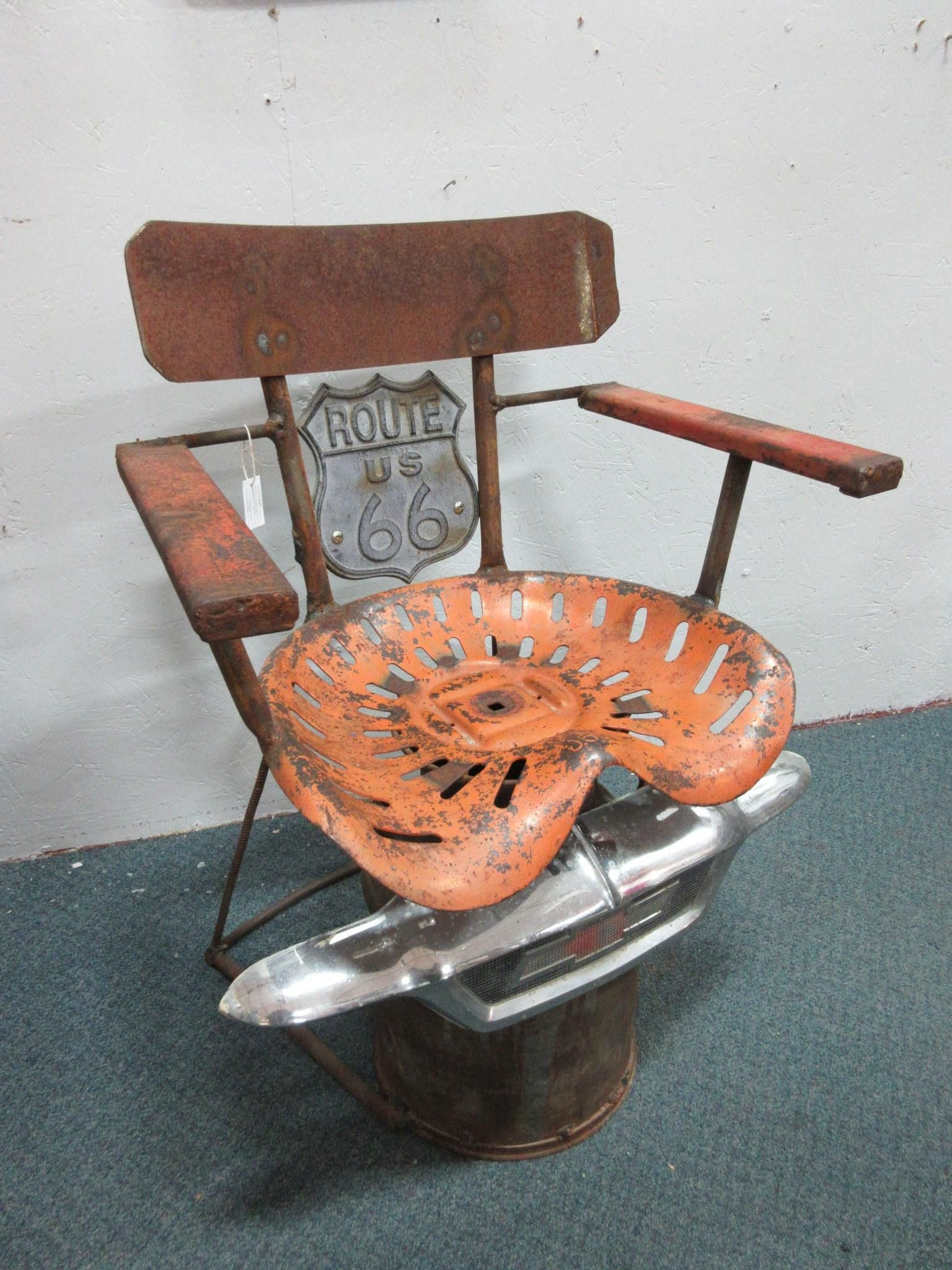 Metal upcycled tractor seat chair From Vendor 165 in booth 6