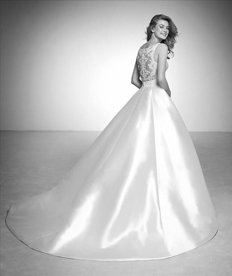 16039dd6e6 Incredible ballgown wedding dress in mikado with a beaded design on the  back and waist. Absolutely wonderful. The ballgown skirt is paired with a  bateau ...