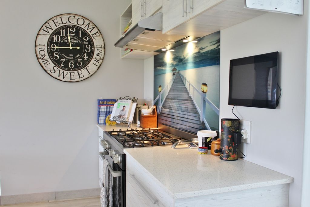 This freehold cluster home with a well appointed kitchen is for sale in Port Alfred