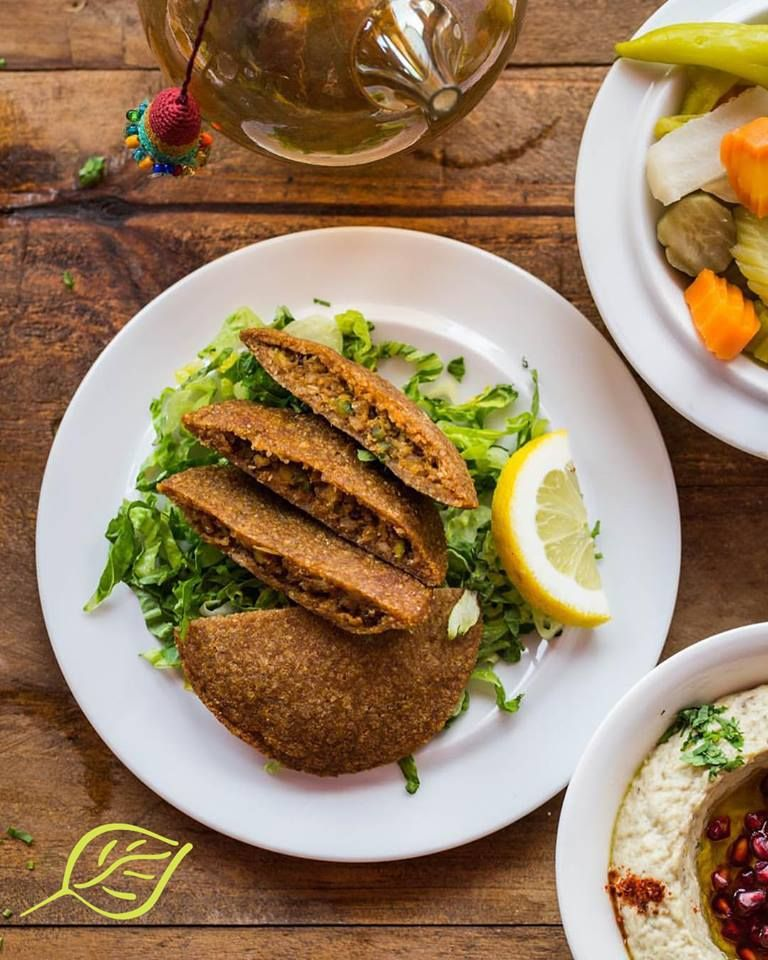 A Perfect Blend Of Fried Mixture Of Ground Meat And Crushed Wheat Stuffed With Walnuts Pistachio And Onion The Kebbe Sajiyeh Cuisine Food Lebanese Cuisine