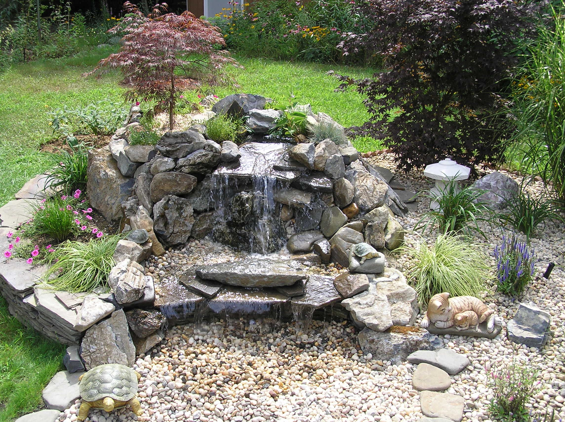 Download full size image bar design backyard waterfalls for Fish pond fountain design