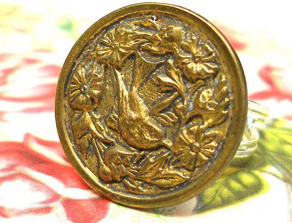 Victorian brass bird button on sterling silver ring.