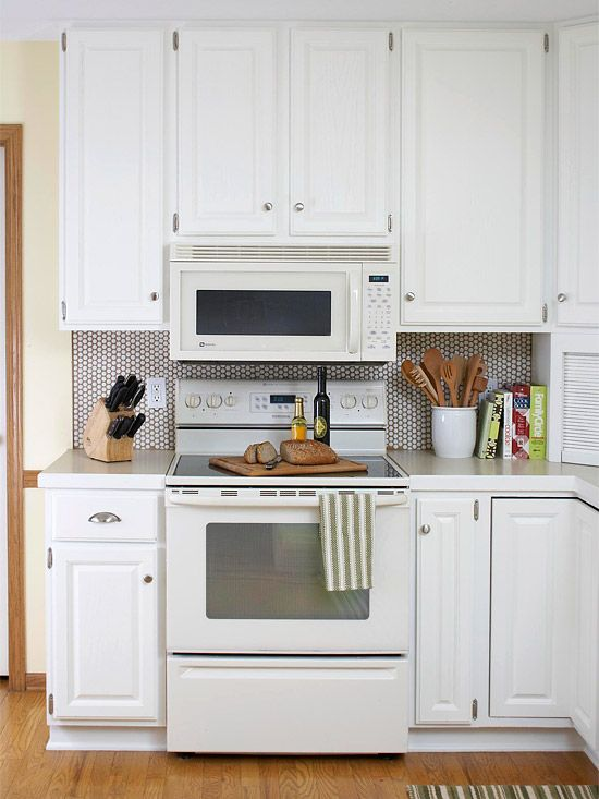 A New White Penny Tile Backsplash Replaced Dated 4x4 Inch Tile And Creates A Stunning Focal Budget Kitchen Remodel Kitchen On A Budget White Kitchen Appliances