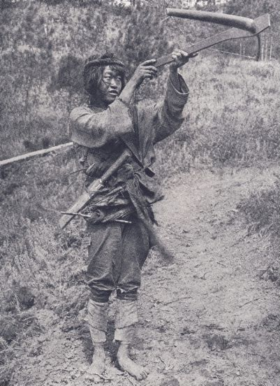 This picture was taken in 1925 by Joseph Rock. His expedition crossed from the Lancang to the Nu valley via the same route we took on last year's Three Rivers expedition. This boy belonged to the Nu people, whose weapons look almost identical to those of the Lisu.