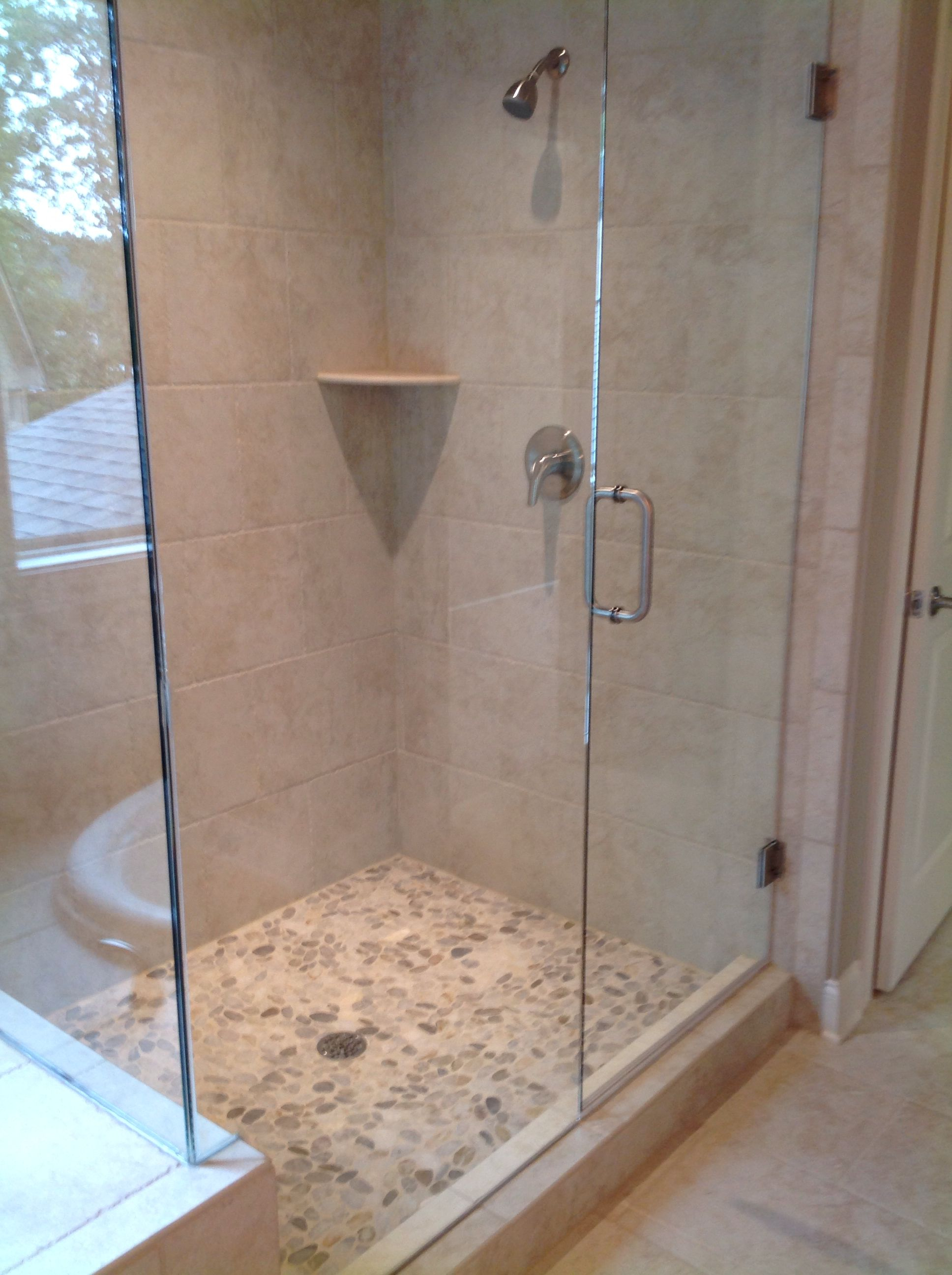 Master Shower With Frameless Glass Door And River Rock Shower Floor