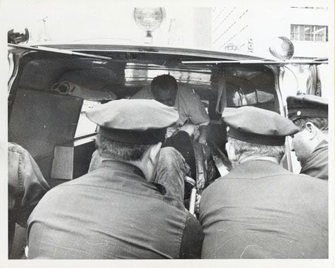 Andy Warhol being lifted into an ambulance after he was shot by Valerie Solanas, June 3, 1968  gelatin silver print  8 1/8 x 10 in. (20.6 x 25.4 cm.)  The Andy Warhol Museum, Pittsburgh; Founding Collection, Contribution The Andy Warhol Foundation for the Visual Arts, Inc.  Photo Jack Smith  TC21.74.2