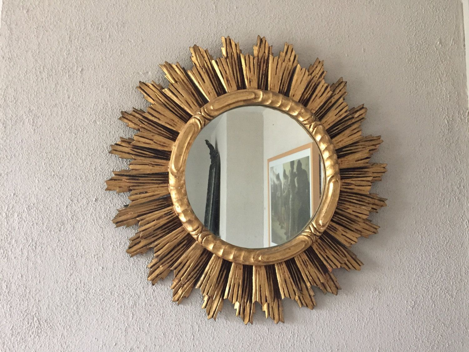 Large old sun gilded wooden mirror