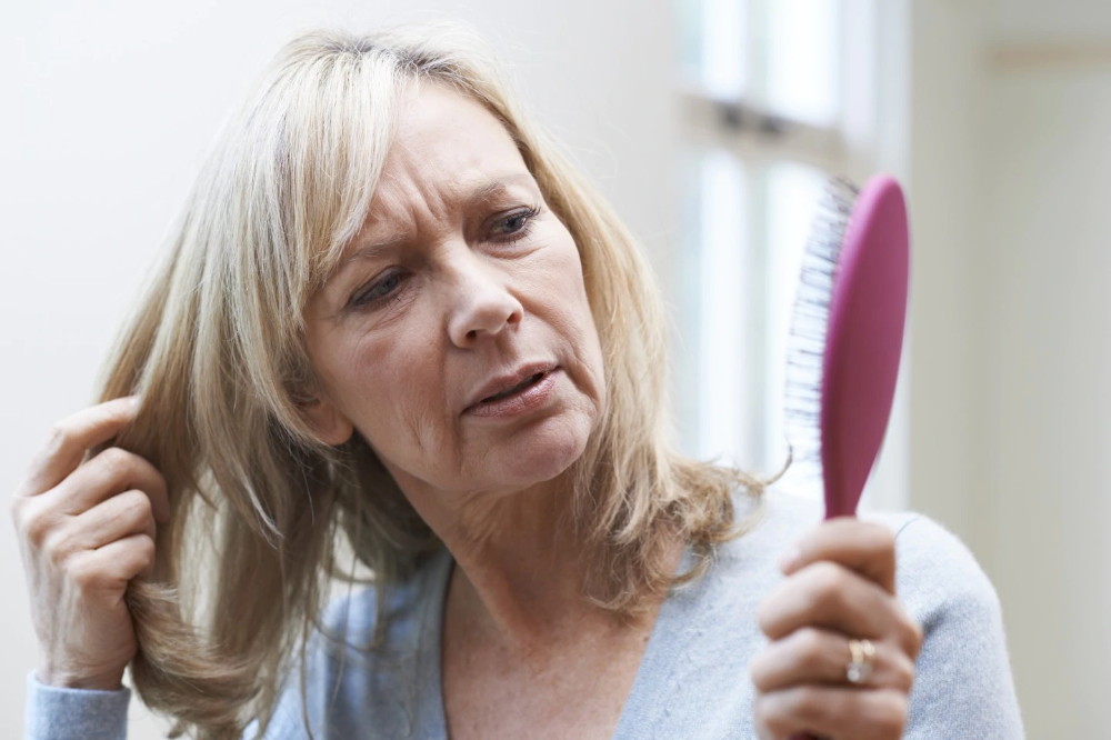 Yes, women experience thinning hair, too. Here's why, and
