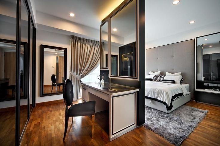 In the master bedroom, a black feature wall separates the sleeping