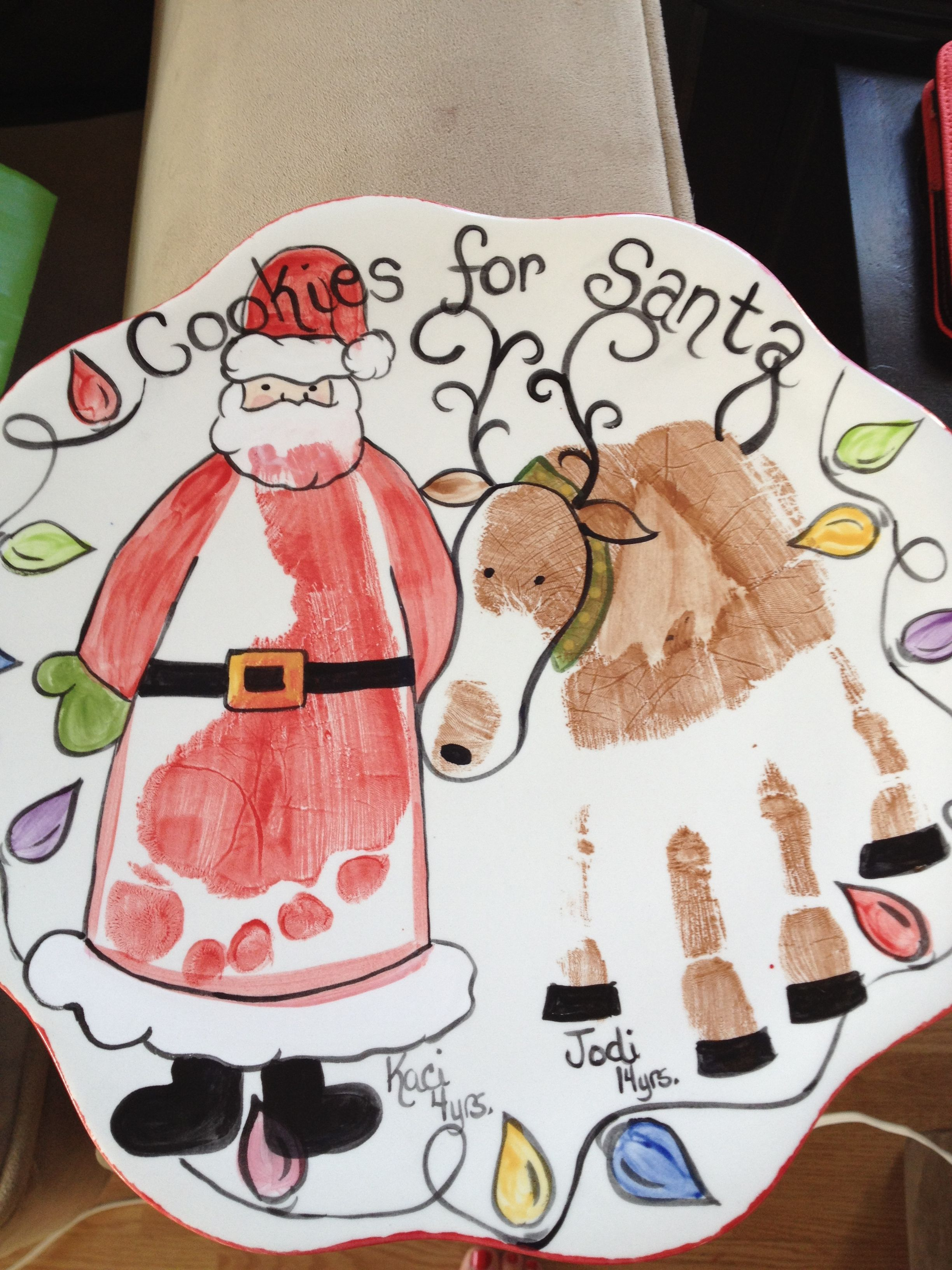 Santa cookie plate Pottery idea using hands & feet to make in the