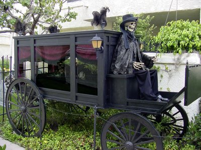 Old fashioned life sized horsedrawn hearse for Halloween