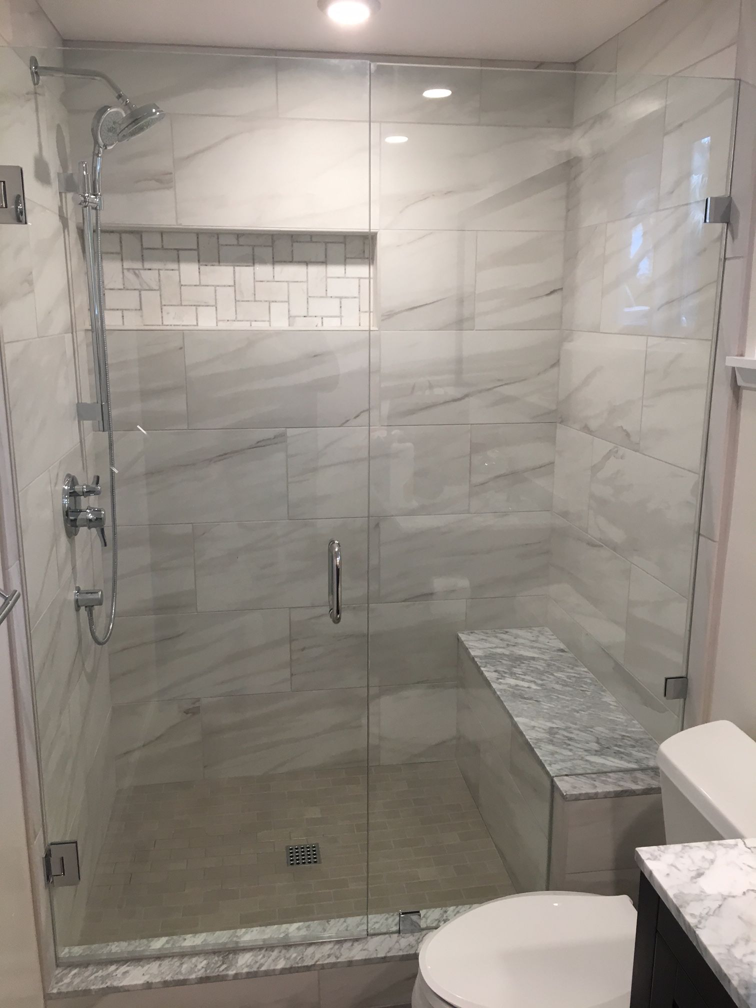 JK Wood Construction Porcelain shower-walls and floor, carrara marble bench and countertop  and accent