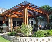 This pergola has some type of shade  screen over the top instead of lattice.  Interesting!