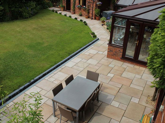 ethically sourced sandstone garden paving from marshalls available as setts walling and step units for perfect design co ordination