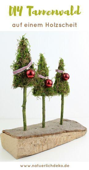 Tannenwald aus Moos auf einem Holzscheit - Natürlich Deko