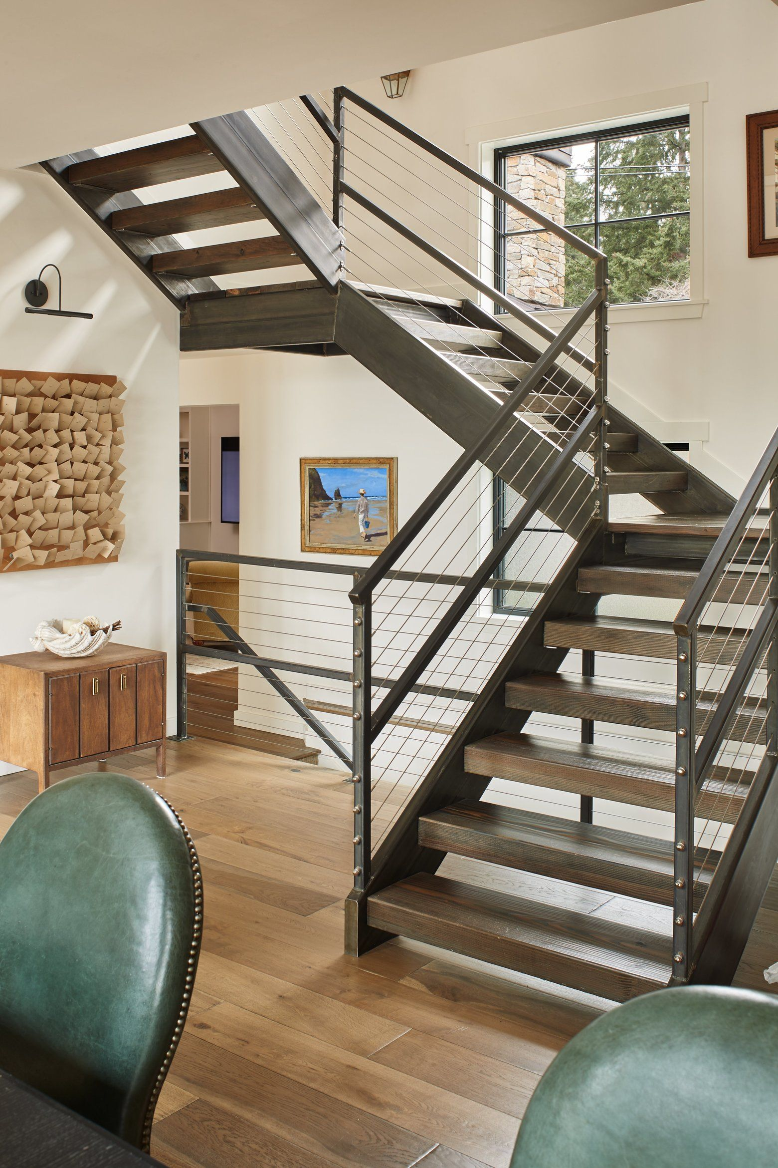 The open staircase to the new second floor (designed and