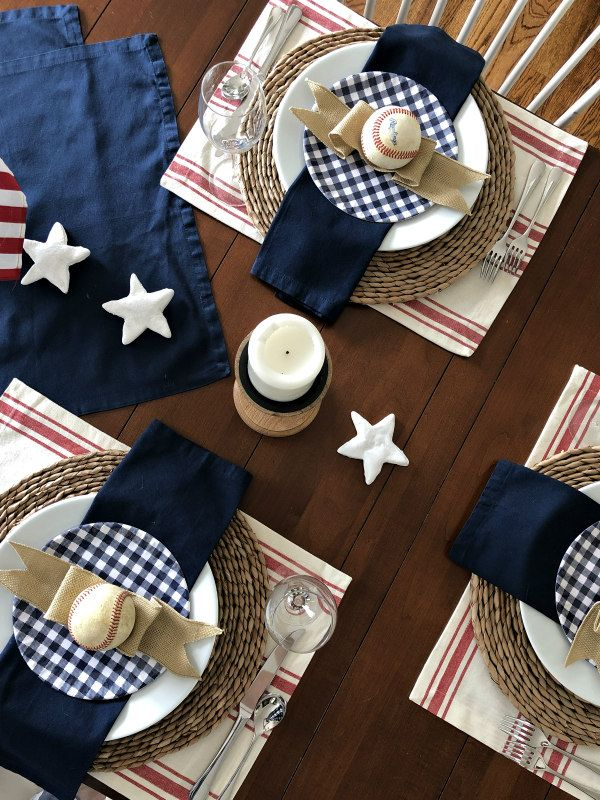 Red, white and blue patriotic table setting celebrating America's favorite pastime. #patriotictable #patrioticdecor #baseballthemed #classicamericana #tablesettings #redwhiteandblue