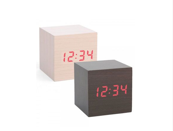 Mini Clap On Alarm Clock // If you don't want an unsightly alarm clock on your bedside table, this could be the answer. The time is only displayed when you clap it on. Most of the time, it just appears to be a classy decorative wooden block.