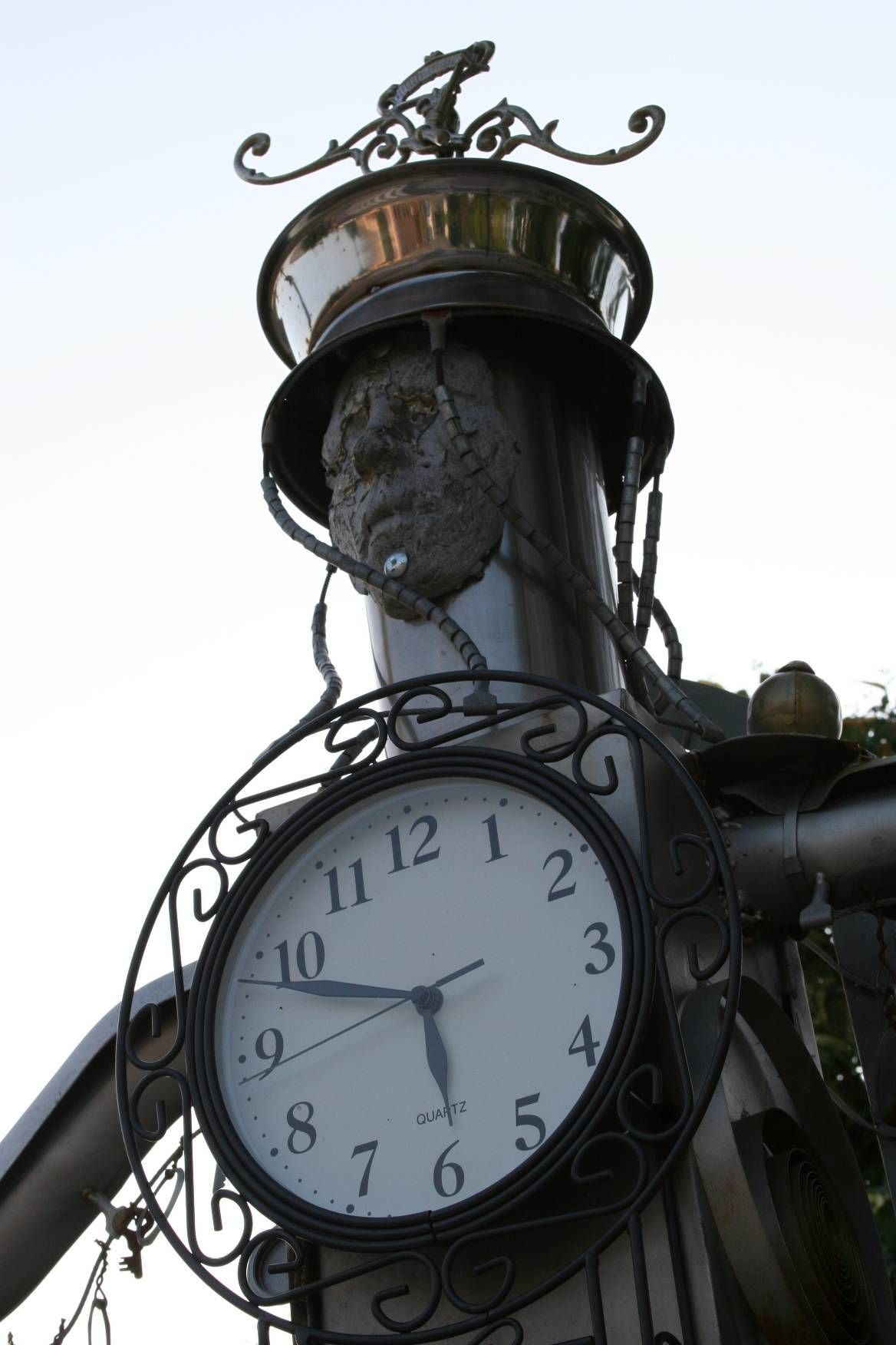 Huge metal clock man.