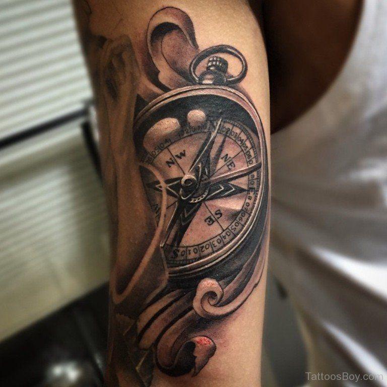 Compass Tattoo On Bicep Tb12069 Jpg 768 768 Compass Tattoo Wolf Tattoo Meaning Nautical Compass Tattoo