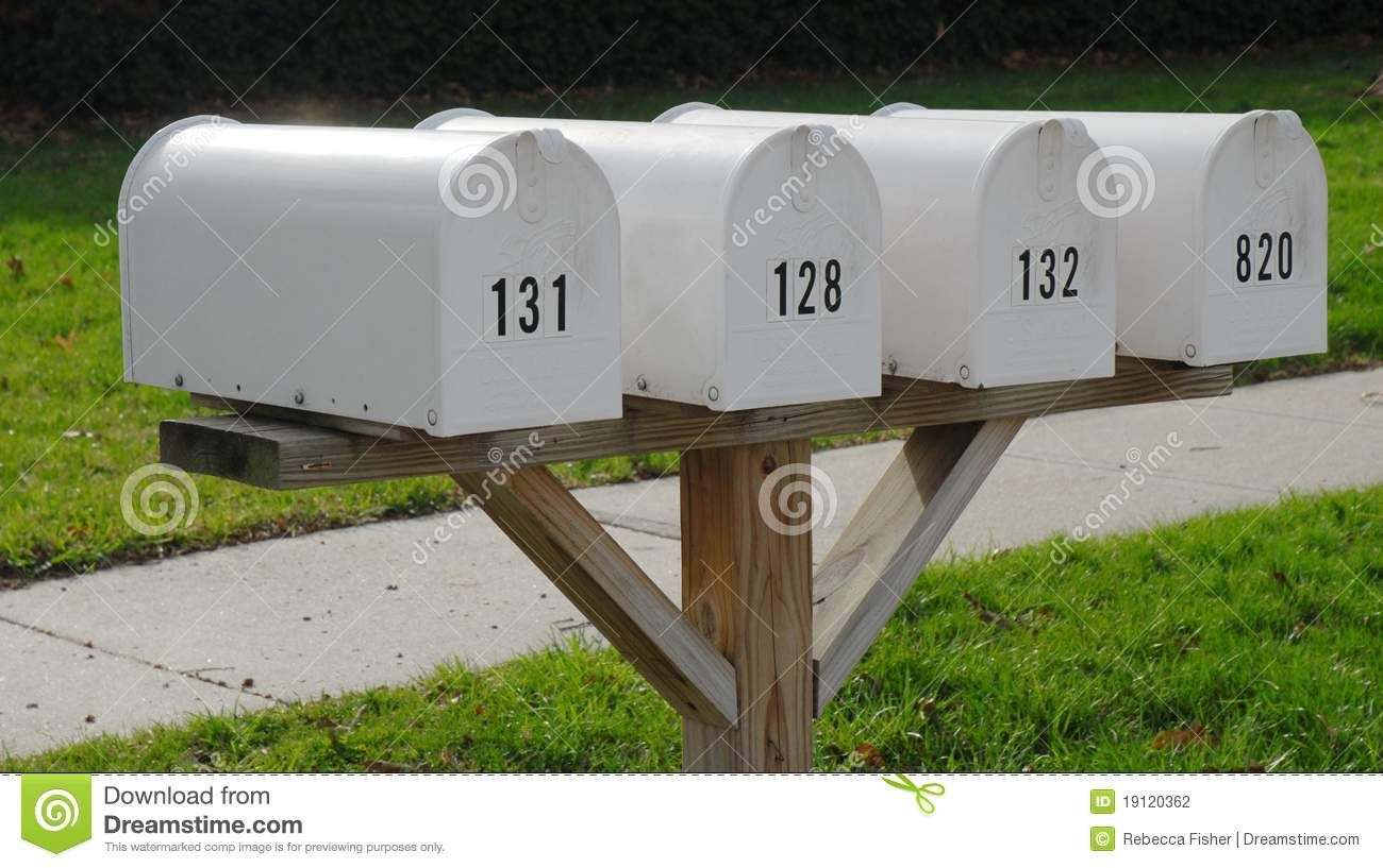 White Mailboxes In A Row With Sidewalk Mailbox Post White Mailbox Mailbox