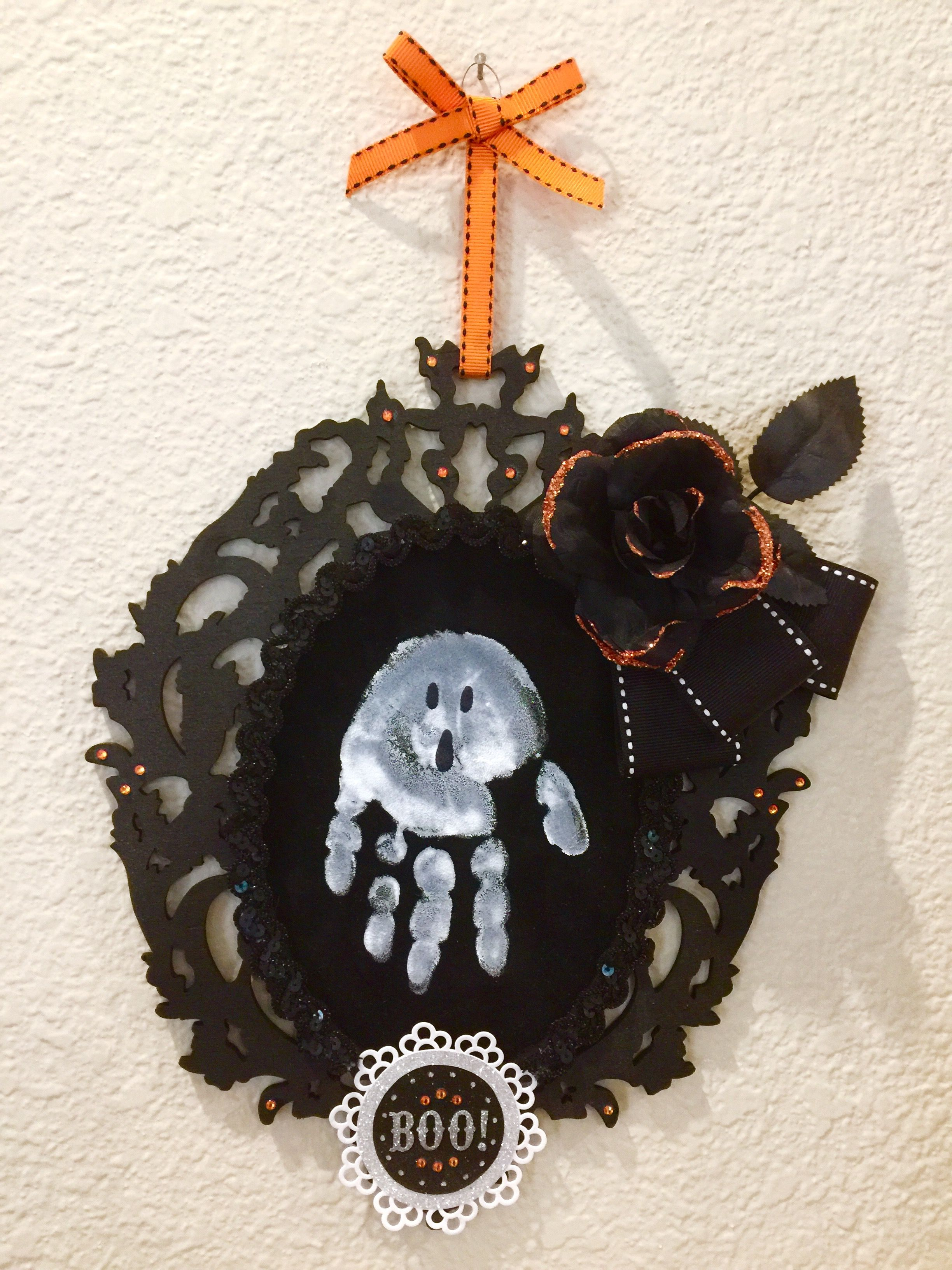 Homemade Halloween ghost hand print hanging keepsake
