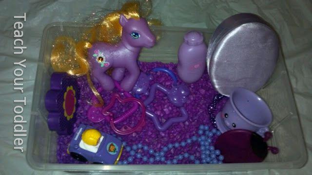 Purple exploration sensory bin with aquarium gravel.