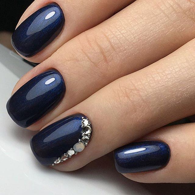 Navy Blue with a glimmer of shimmer and rhinestone encrusted accent nail. - Navy Blue With A Glimmer Of Shimmer And Rhinestone Encrusted