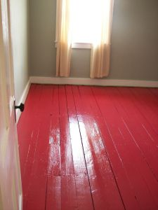 Red Painted Floors White Trim And Gray Walls