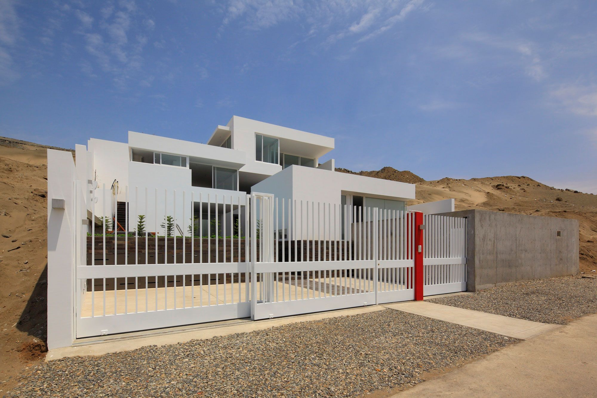 White Gate Also Concrete Wall Fence Near Brown Stone Wall Architecture House Designs Exterior Modern Fence Design