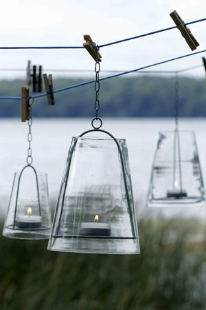 very cool outdoor lanterns ~ want to spend more time looking on this site later