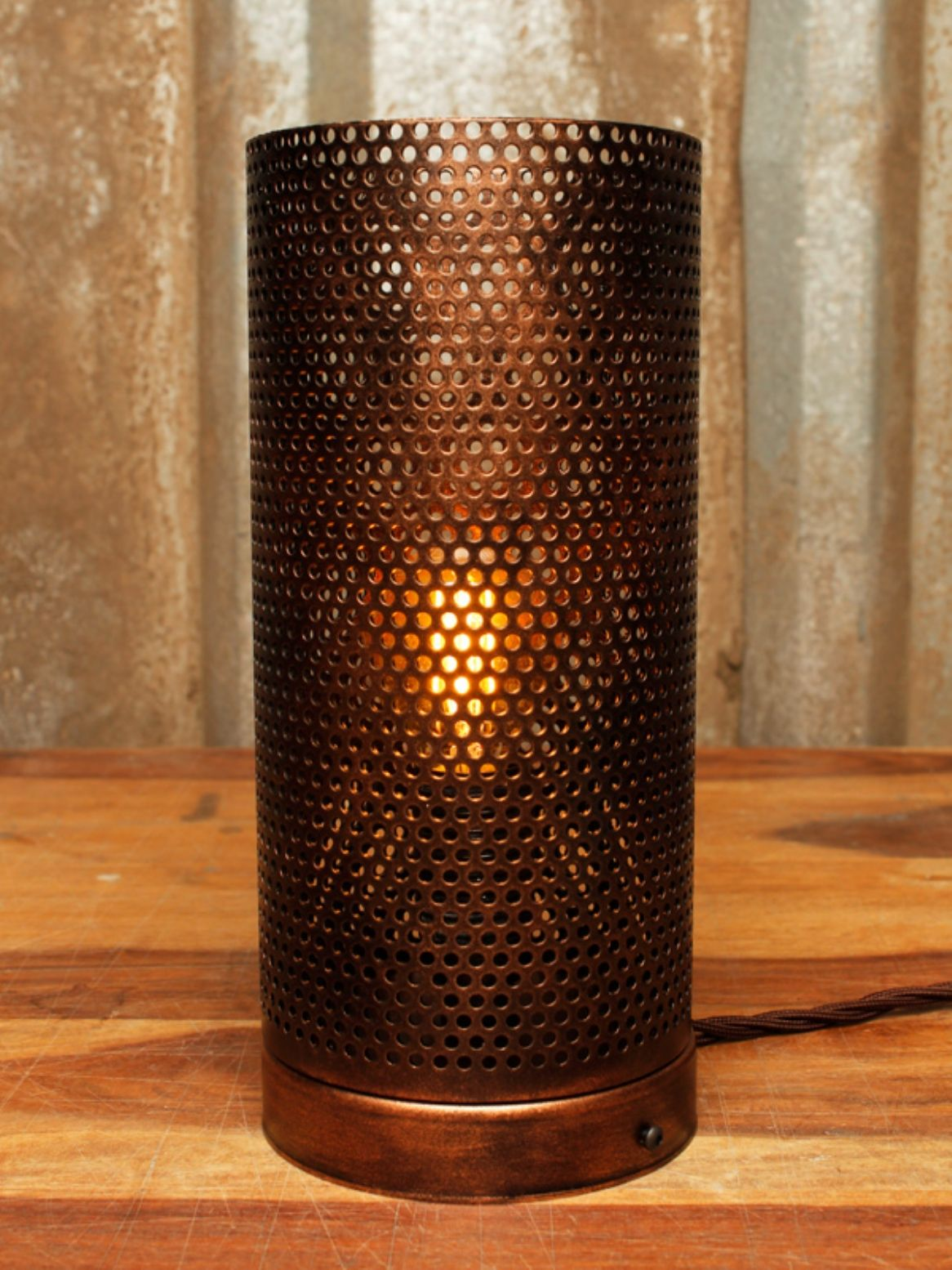 Industrial Style Table Lamp With A Perforated Mesh Shade In A Bronze Spray Finish Industrial Style Lamps Industrial Style Table Lamp Table Lamp