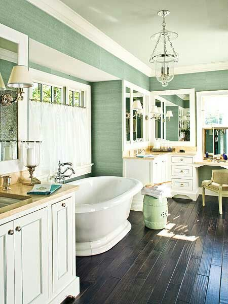 Wood floors, white cabinets, light green paint, crown molding, chandelier, bathroom