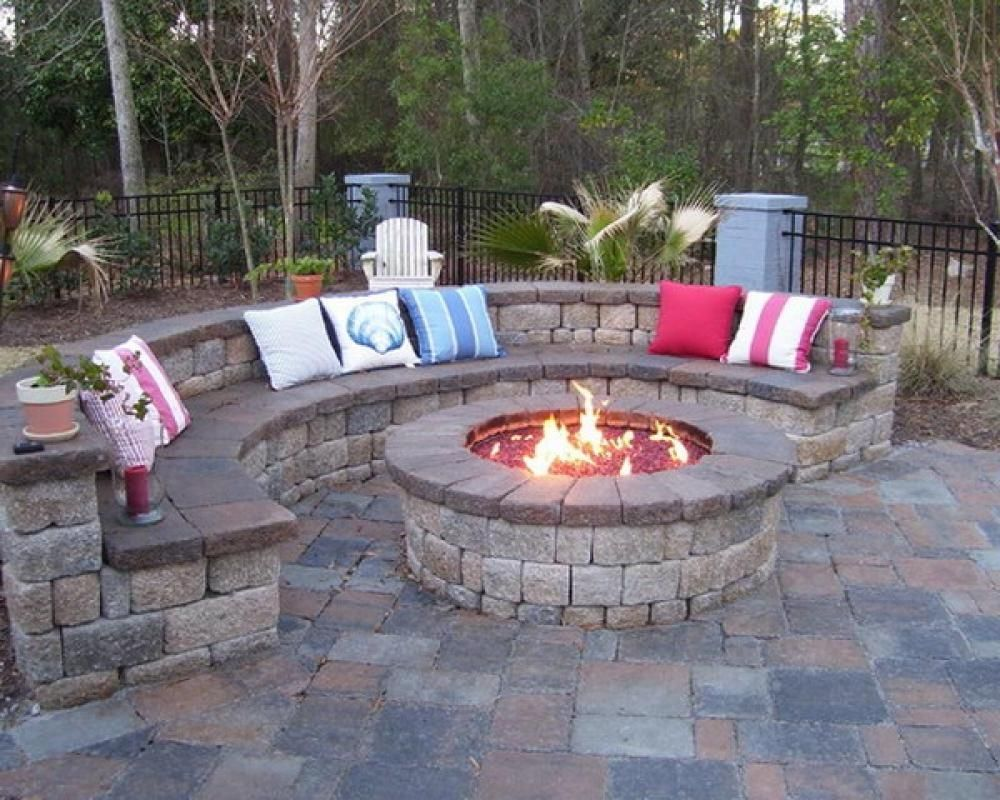 Backyard Landscape And Patio Design With Outdoor Fireplace Ideas Also Curved Stone Bench Seating And Outdoor Cushions With Outside Fire Pits Plus Fence Design For Outdoor Design Throughout Stone Patio Ideas Artistic Stone Patio Ideas