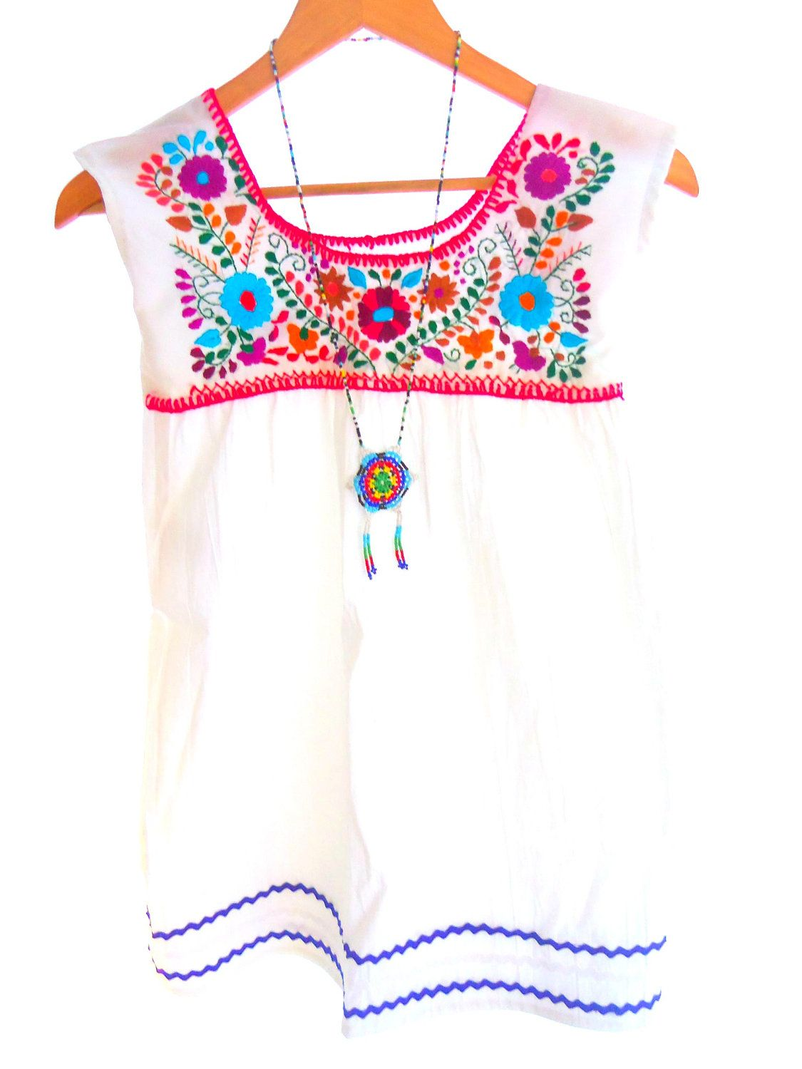 Snow white Handmade Embroidered Cotton Mexican Baby Tunic Dress. $39.00,  via Etsy.