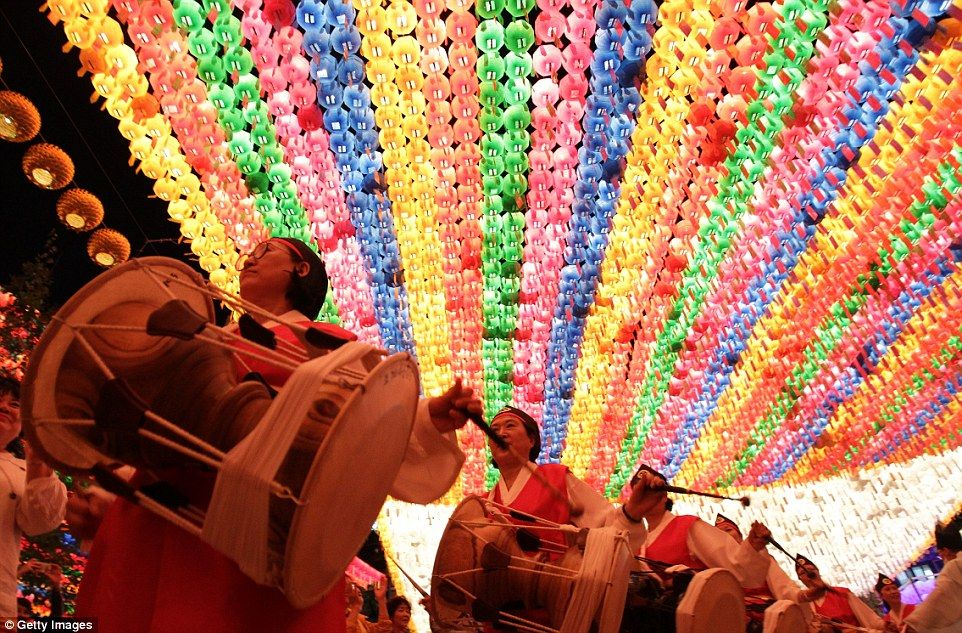 Noisy: A band of drummers parades through Seoul and walks under the lights at the Jogye Temple as part of their route through the city