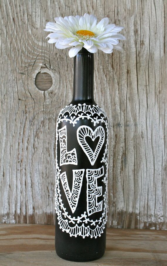 Painted wine bottle love black and white wedding for Painted wine bottle wedding centerpieces