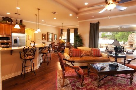 The Great Room opens to an outdoor fireplace and patio  One