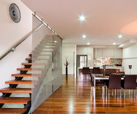 i love this wire mesh dividing wall along the staircase!