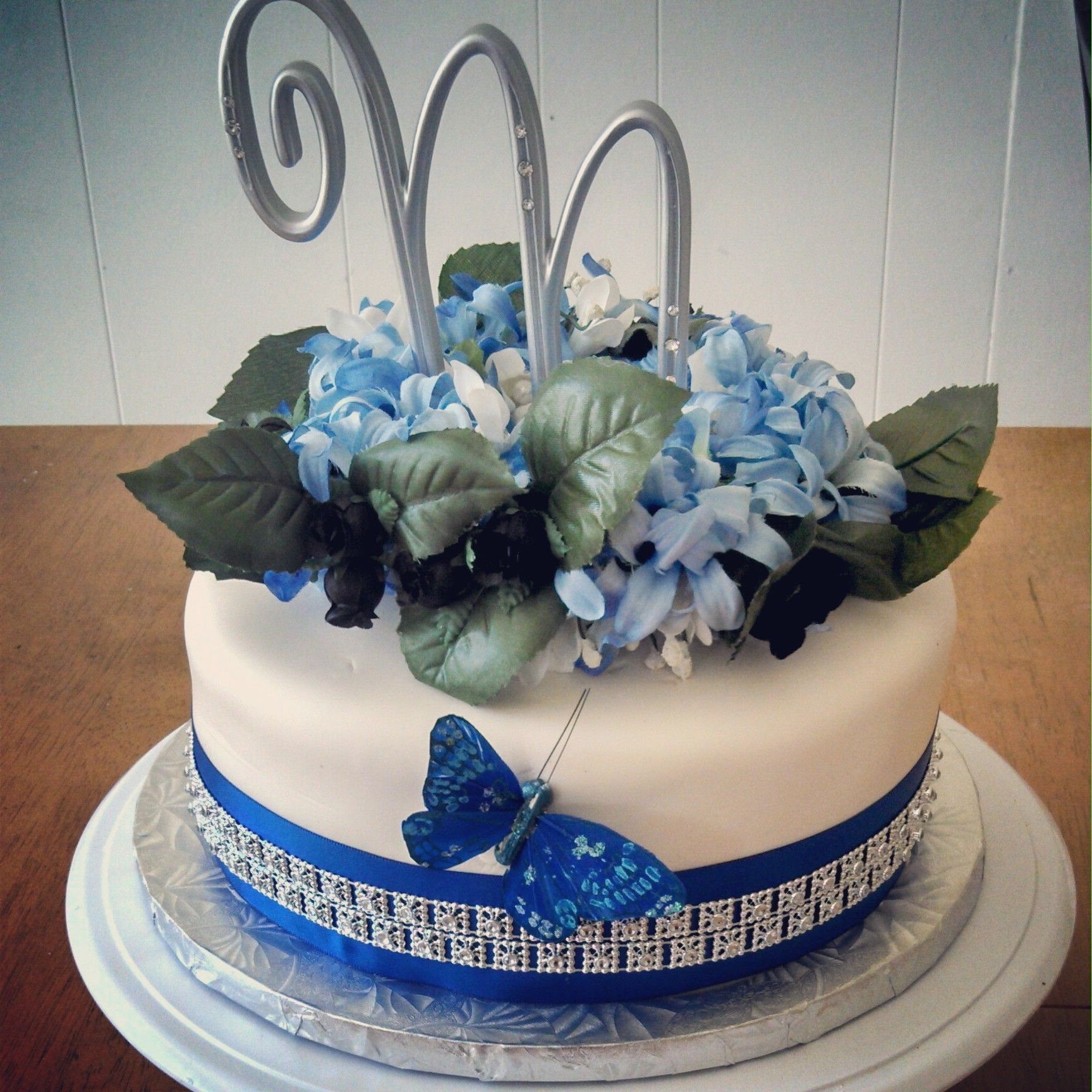 Small wedding cake with butterfly, ribbon, sparkle ribbon, artificial flowers and monogram  #trinitybaking #trinity #baking  www.trinitybaking.vpweb.com