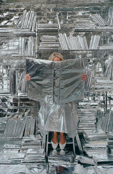 """Lost in My Life (wrapped books)"" (2010), by Rachel Perry Welty. Part of Welty's series Lost in My Life."