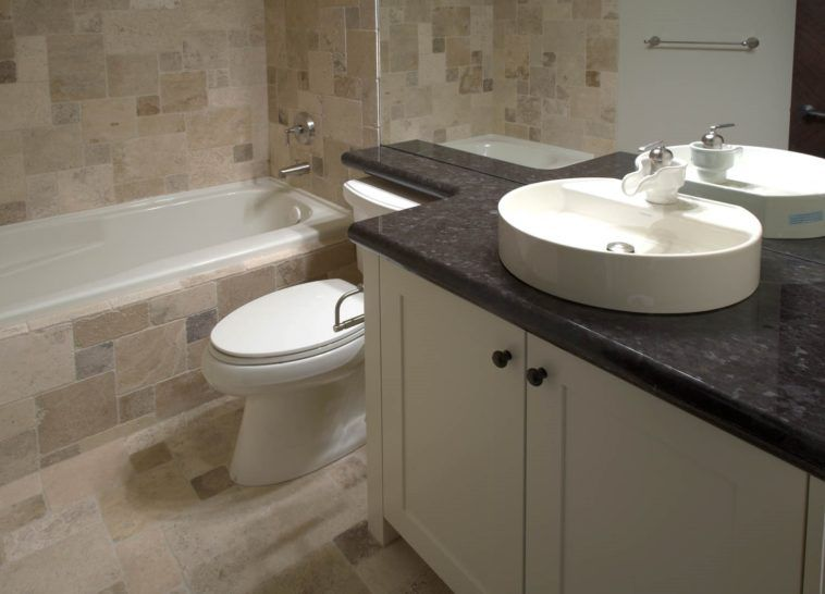 White Wooden Vanity Cabinet With Round White Sink Placed On Black