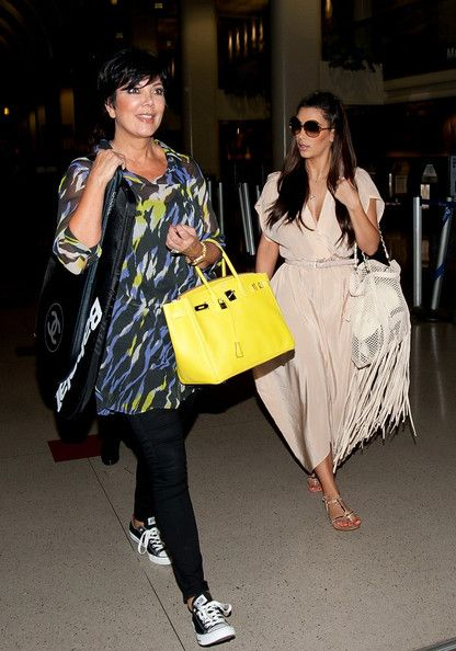 Kris Jenner Photos Photos  The Kardashians Text Together at the Airport 14d2b26ef7